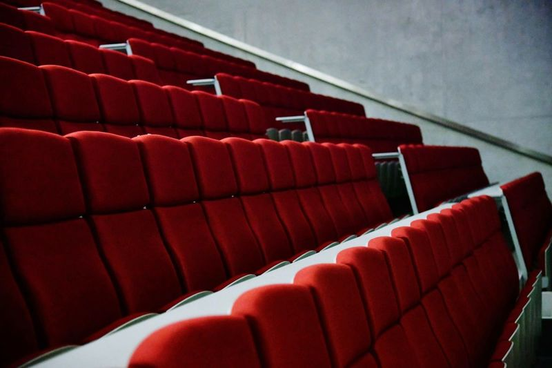 Red empty chairs in movie theater