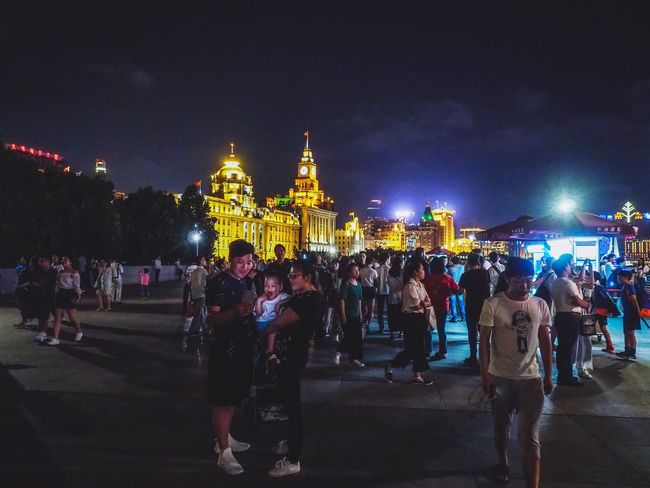 China Shanghai, China Shanghai Night Architecture Illuminated Built Structure City Building Exterior Group Of People Real People Travel Destinations Sky Crowd Nature Men Travel Tourism Large Group Of People Transportation Street Leisure Activity Outdoors