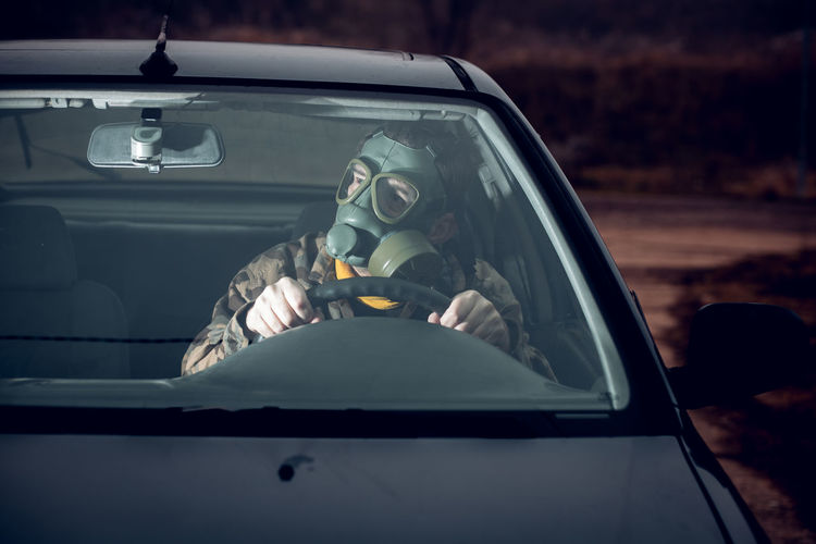 Midsection of man sitting in car