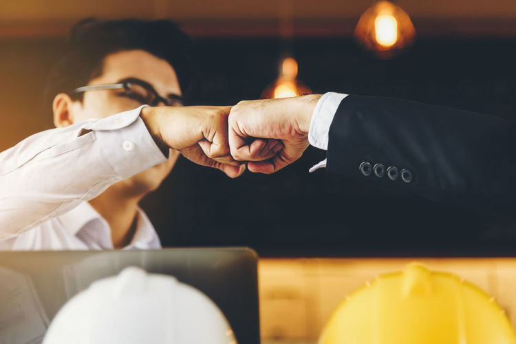 Businessman giving fist bump to colleague