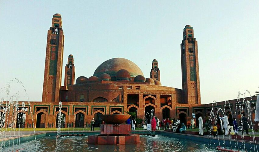 Water Travel Destinations Architecture Arch Religion Tourism History Large Group Of People Built Structure Marble Day Outdoors People Sky Adults Only Adult Bahria Masjid Bahria Town, Lahore Pakistan