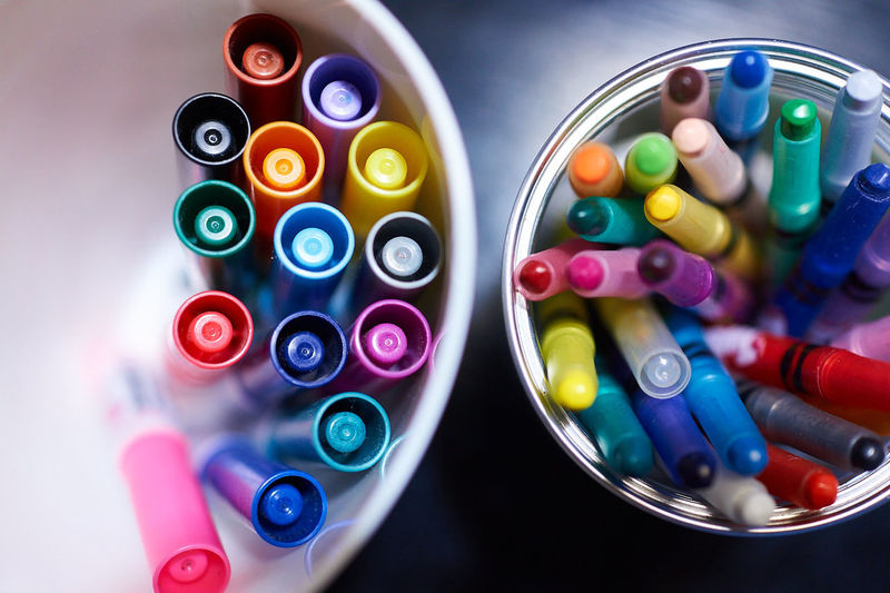 High Angle View Of Colored Pens In Container