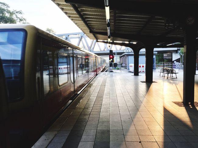 The Berlin S-Bahn at Westkreuz. Public Transportation Railroad Station Berlin Sunlight