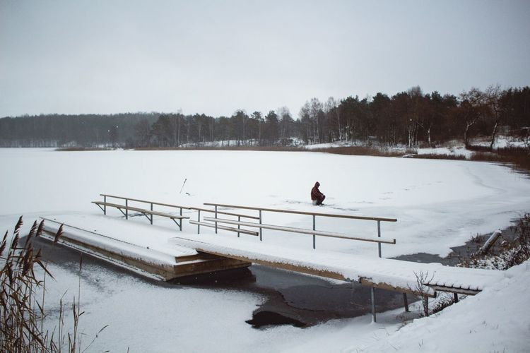 Pier over frozen lake during winter