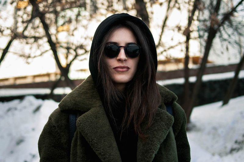 Warm Clothing Winter Portrait Fashion Tree Cold Temperature Hood - Clothing Looking At Camera Sunglasses Nature Outdoors Urban Style Moscow City Moscow Life Russia City Life Real People Urban Fashion Urbanphotography Urban Lifestyle Beautiful Woman Beautiful People One Person Winter Looking At Camera