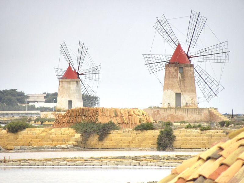 Trapani Salt Flats Salt Flat Salinas Windmill Wind Turbine Traditional Windmill Architecture No People Day Water Clear Sky Red Wind Power Alternative Energy Salt Scenics Sicily Waterfront Investing In Quality Of Life Your Ticket To Europe