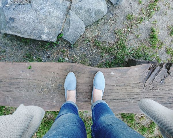 Standing strong... Human Body Part Jeans Legsinjeans Shoes Fashion Bluejeans Lookingdown On A Bench Woodenbench Rocks