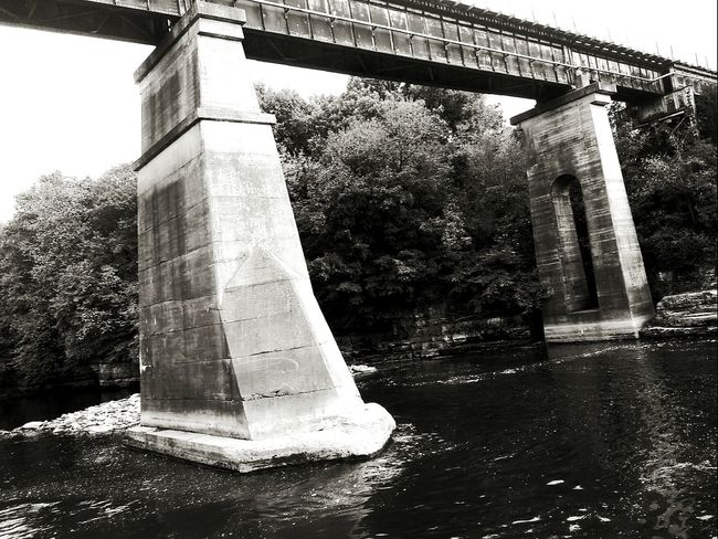 Fishin by the dam Architecture Built Structure Water Bridge - Man Made Structure Outdoors Low Angle View Architectural Column Check This Out Picturejunkie Iowa Pretty♡ Trainbridge Blackandwhite Photography By The River Iowariver