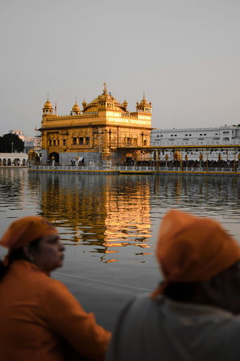 On my knees, I bow to thee. I know you hear, I know you see... O lord 🙏 InMakin! Selective Focus Golden Temple Golden Temple, Amritsar Sikh Sikhism Religious Architecture Harmandir Sahib Religion Gold Outdoors Words Selective Focus Water Clear Sky Dome Rear View Sunset Reflection Sky Architecture Spirituality Place Of Worship Stories From The City This Is Family