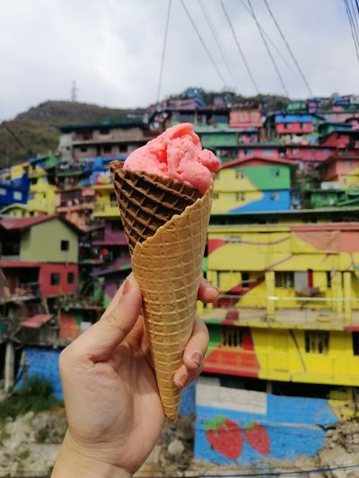 strawberry ice cream Anchobi Delicious Strawberry Ice Cream Pink Color Colorful Human Hand Ice Cream Frozen Food Ice Cream Cone Dessert Holding Multi Colored Personal Perspective Close-up Sky Human Finger Cityscape Residential District