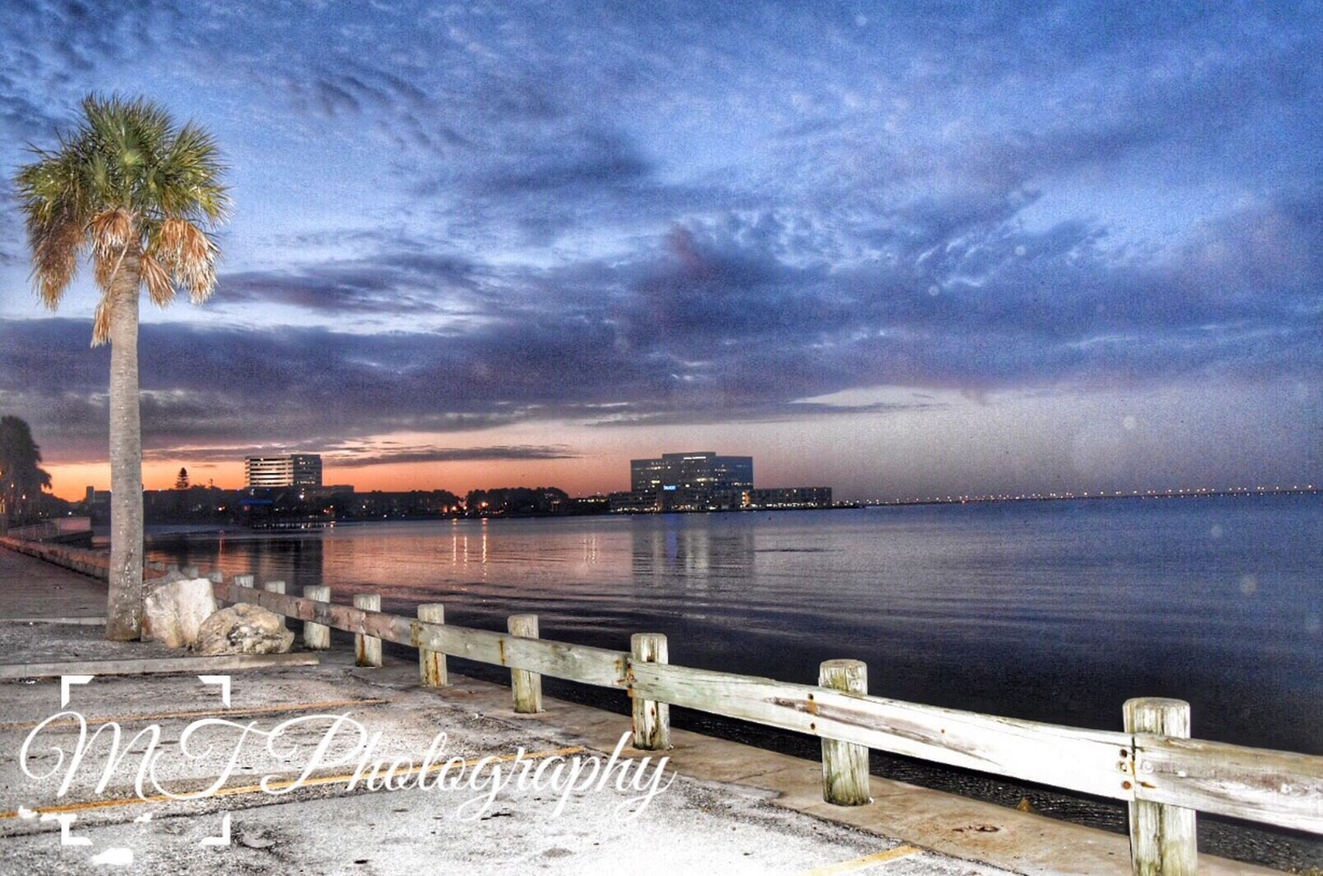 sky, water, cloud - sky, sea, built structure, pier, architecture, building exterior, cloudy, scenics, tranquility, beach, nature, beauty in nature, tranquil scene, railing, cloud, sunset, dusk, weather