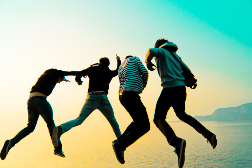 Clear Sky Friendship Full Length Fun Group Of People Land Leisure Activity Lifestyles Men Motion Nature People Real People Rear View Sea Sky Togetherness Water Women