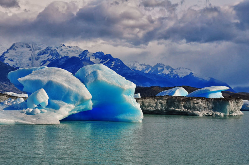 Floating icebergs in Lago Argentino, Prov. de Santa Cruz, Argentina. Beauty In Nature Cloud - Sky Cold Temperature Environment Frozen Glacier Iceberg Iceberg - Ice Formation Melting Mountain Mountain Range Nature Non-urban Scene Outdoors Scenics Sea Season  Sky Snow Tranquil Scene Tranquility Water Waterfront Weather Winter