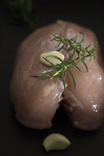 Black Background Chicken Rosemary Before Baking Chicken Brests Close-up Food Food And Drink Freshness Garlic Herb Indoors  Ingredient Meat No People Raw Food Spice Unbaked