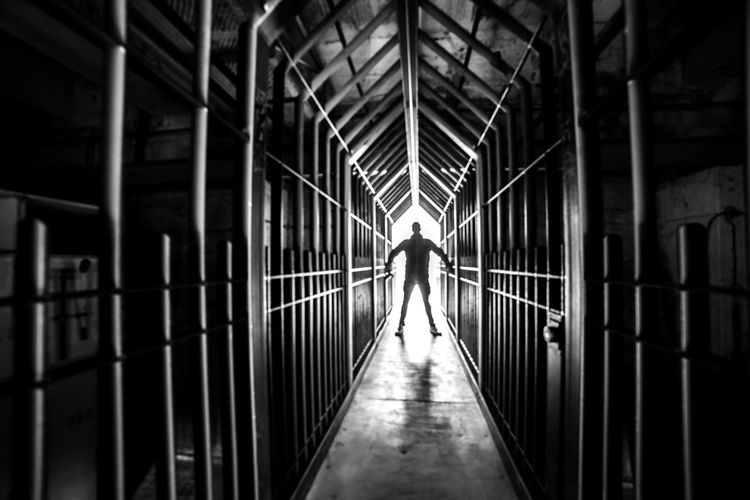 Urbex - 33 Architecture Real People One Person Direction Full Length The Way Forward Rear View Built Structure Walking Lifestyles Indoors  Men Building Bridge Railing Day Leisure Activity Diminishing Perspective Footbridge Light At The End Of The Tunnel