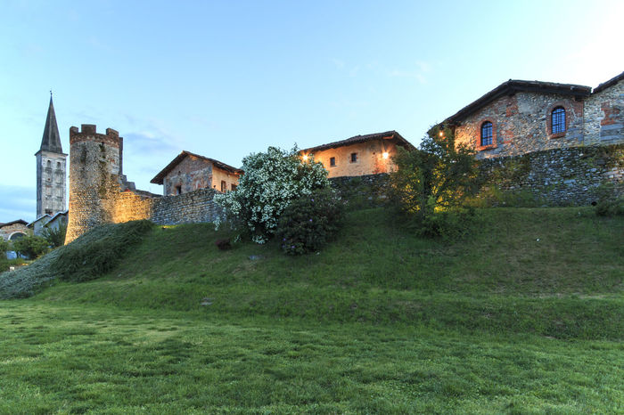 Candelo, Biella - May 4, 2016: Panoramic view of the Medieval village of Ricetto di Candelo in Piedmont, used as a refuge in times of attack during the Middle Age. Architecture Biella Blue Building Building Exterior Built Structure Candelo Candelo In Fiore Day Exterior Grass Grassy Green Color Growth House Italy Medieval Village Nature No People Outdoors Plant Residential Building Residential Structure Ricetto Di Candelo  Sky