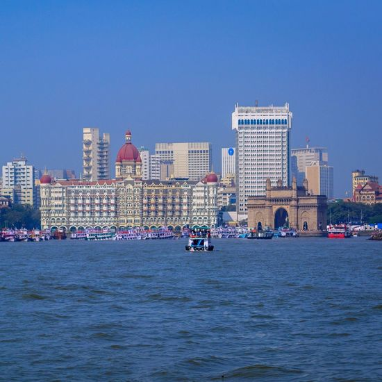 the beauty of Mumbai from a different perspective Gatewayofindia HotelTaj Coastline Architecture Modern Cityscape Urban Skyline City Skyscraper Blue Water Outdoors Building Exterior Day