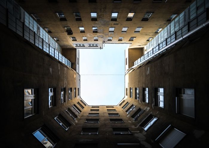 Launch Lookingup Hungary Magyarország Budapest EyeEm Selects Architecture Built Structure Building Building Exterior Window City Low Angle View No People Day Sky Residential District Outdoors Directly Below Tall - High In A Row Clear Sky Wall - Building Feature The Way Forward
