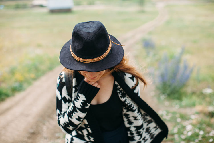 Black Color Casual Clothing Close-up Day Female Girl Grass Hat Lifestyles Nature Outdoors Smile Traveling Windy
