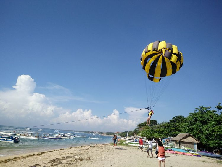 Adventure Blue Day Enjoyment Extreme Sports Fun Leisure Activity Lifestyles Nature Paragliding Scenics Sky Sport Tourism Tourist Tranquil Scene Tranquility Unrecognizable Person Vacations Bali, Indonesia Tanjungbenoa Nusadua Parasailing Watersports