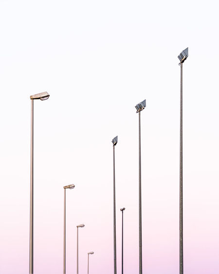 Low Angle View Of Street Lights Against Clear Sky During Sunset
