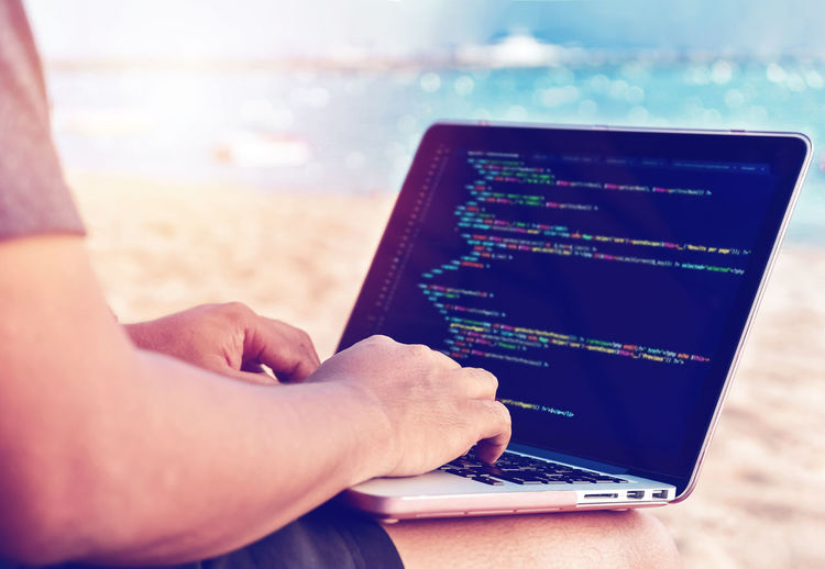 Assignments Freelance Life Freelancer Hands Programming Working Beach Close-up Coding Communication Human Hand Javascript Leisure Activity Lifestyles Nature Outdoors Php Programmer Relaxation Source Code Technology Typing Using Laptop Water Wireless Technology