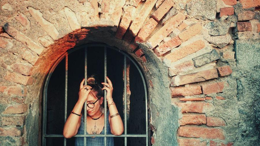 Woman Leaning On Window On Wall