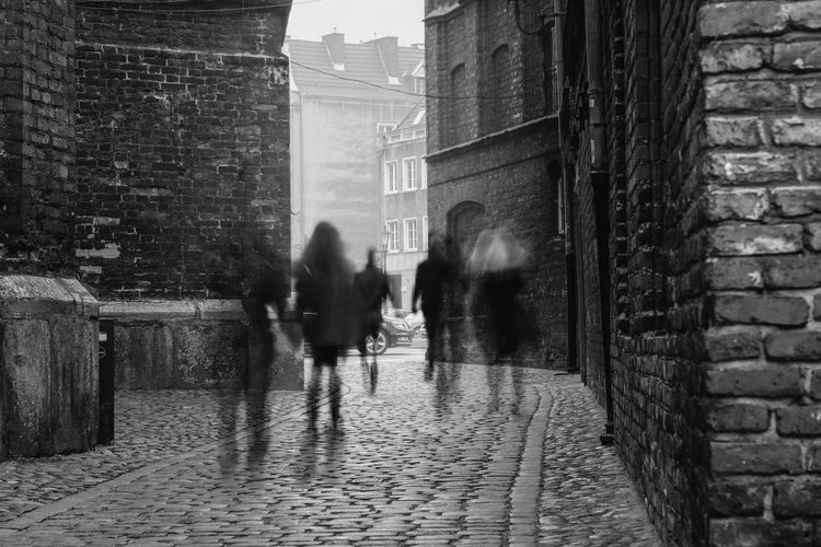 Ghosts of Old Town [12/365] 2016.10.21 I got a spontaneous idea while I was running some errands in Gdańsk's Old Town. This is a multiple exposure shot composed together in PS with some masking involved, each 'ghost' was caught separately during their stroll down the street seen in the picture, and both the first and second plane were exposed extra to provide a fog-like effect. I also used a 5 stop ND filter since it was the only one I happen to have with me. Architecture Black & White Black And White Blackandwhite Blurred Motion Building Exterior Built Structure City Exposure Bracketing Exposure Experimentation Foggy Ghost Ghosts Long Exposure Monochrome ND Filter Outdoors People Rain Real People Street Streetphoto_bw Streetphotography Walking Wet