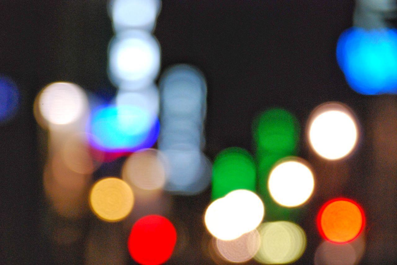 illuminated, defocused, night, multi colored, no people, lighting equipment, light - natural phenomenon, glowing, light, circle, geometric shape, lens flare, shape, close-up, architecture, electric light, city, pattern, indoors, light effect, nightlife