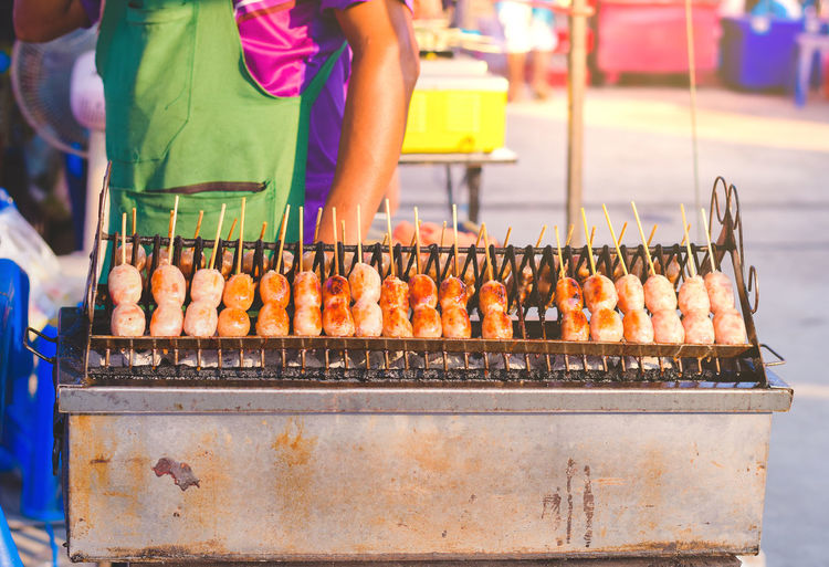 Man preparing food for sale at market stall