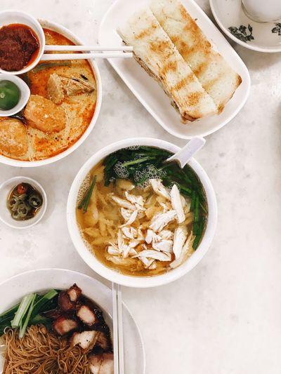 Local breakfast ASIA Breakfast Noodles Malaysian Food Malaysian Food Food And Drink Freshness Ready-to-eat Still Life Healthy Eating Table High Angle View Bowl Directly Above Indoors  Wellbeing Serving Size Meal No People Vegetable Bread Plate Indulgence Eating Utensil