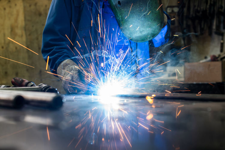 Welder working in an industrial factory
