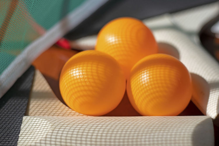 Close-up of yellow balls on table