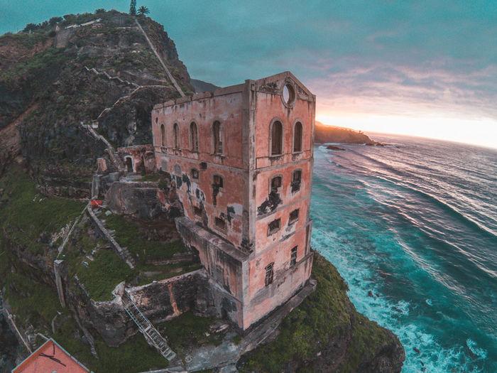 Old ruin building by sea