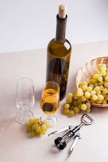 Alcohol Bottle Container Corkscrew Drink Drinking Glass Food Food And Drink Freshness Glass Glass - Material Household Equipment Indoors  No People Olive Oil Red Wine Refreshment Still Life Studio Shot Table White Background Wine Wine Bottle