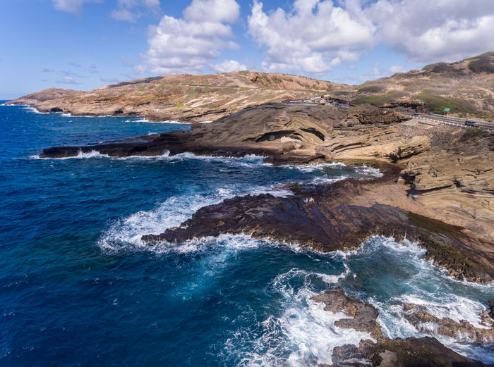 Aerial view of the rugged coastline on the east coast of Oahu Hawaii Hawaii Oahu Travel View Aerial Beach Beauty In Nature Blue Cloud - Sky Day Destinations Land Motion Nature No People Ocean Outdoors Power In Nature Rock Rock Formation Rocky Coastline Scenics - Nature Sea Sky Water
