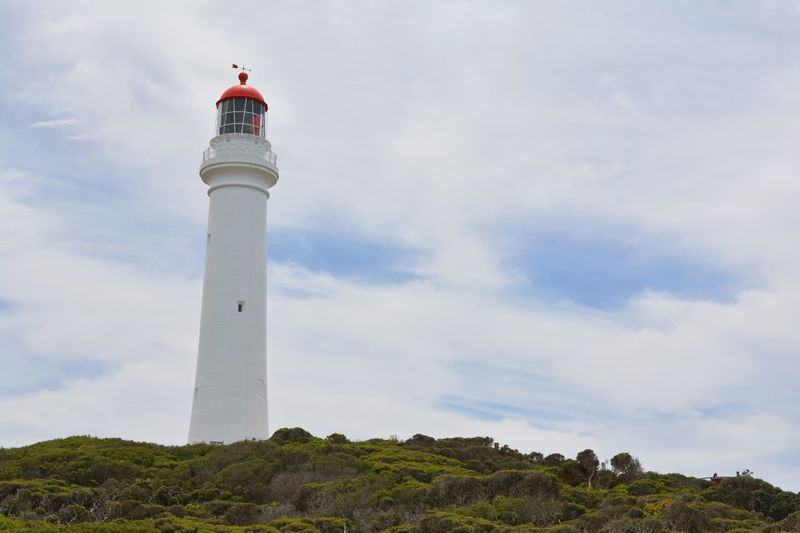 Architecture Building Exterior Built Structure Cloud Cloudy Direction Dusk Famous Place Great Ocean Road Guidance International Landmark Lighthouse No People Outdoors Protection Round The Twist Safety Sky Split Point Split Point Lighthouse Sunset The Great Ocean Road Tower