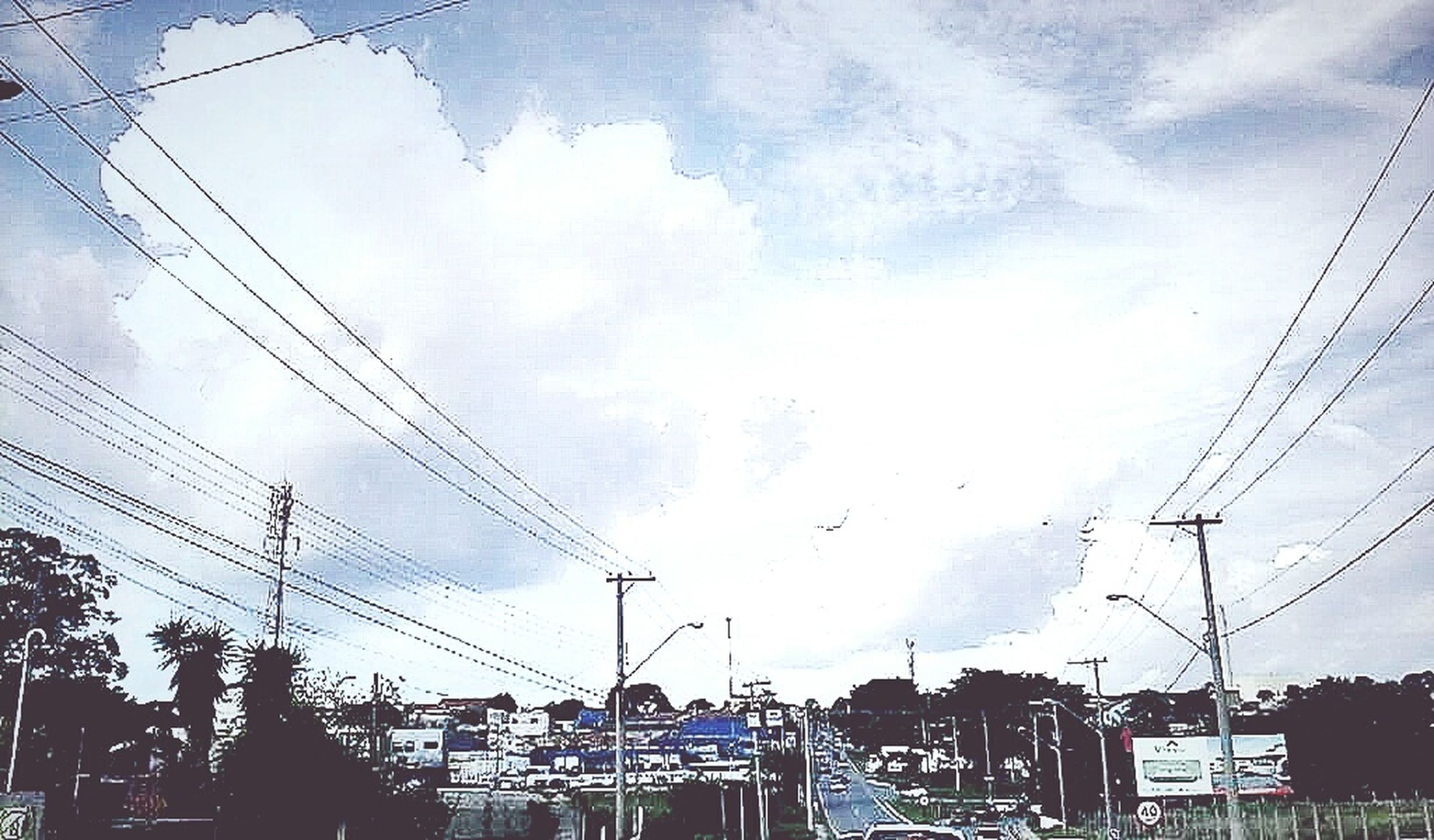 power line, electricity pylon, cable, electricity, power supply, sky, building exterior, low angle view, connection, built structure, architecture, power cable, silhouette, fuel and power generation, cloud - sky, city, technology, cloud, outdoors, no people