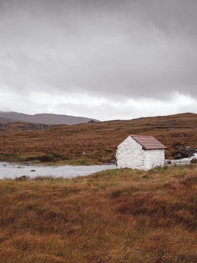 solitary white house in amidst a vast irish landscape Connemara Connemara National Park Connemara, Landscape, Lake, Ireland, Galway White House White House Red Roof White House In Wilderness Irish Landscape House In Wilderness Solitude Philipp Dase