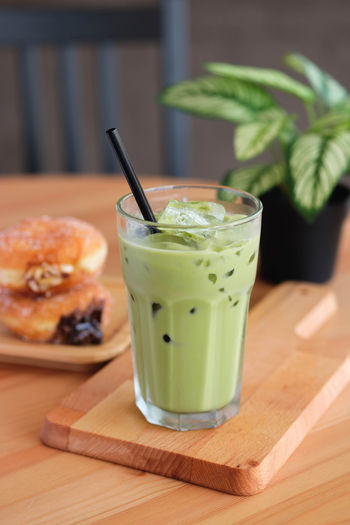 Food And Drink Food Table Drinking Straw Freshness Straw Drink Household Equipment No People Glass Drinking Glass Focus On Foreground Wood - Material Healthy Eating Indoors  Close-up Still Life Refreshment Ready-to-eat Leaf Mint Leaf - Culinary Herb Breakfast Matcha Latte