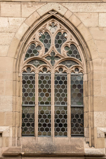 Window of an old historical building Built Structure Architecture Building Exterior Arch Place Of Worship Building Religion Belief Day Spirituality Entrance Closed Window No People The Past Door History Pattern Outdoors Ornate