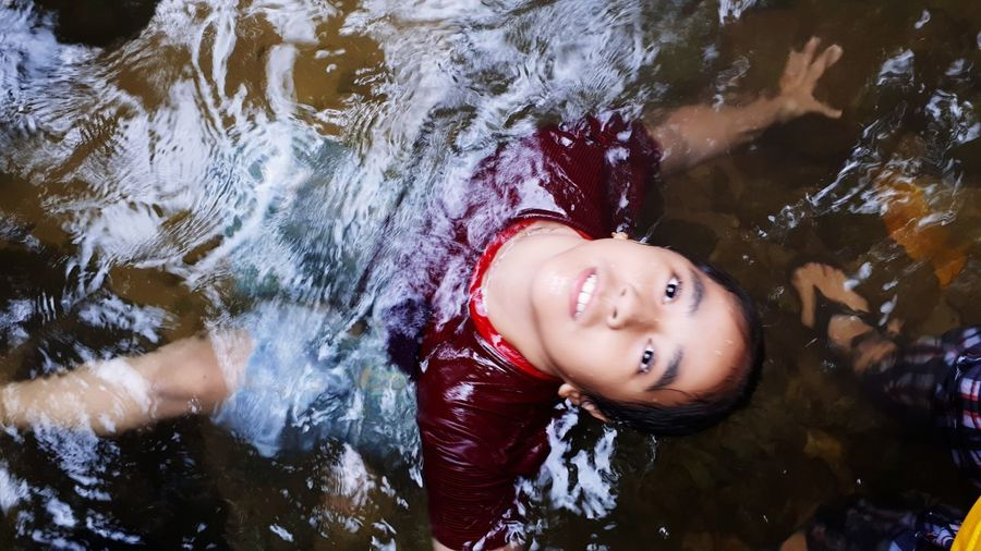 High Angle View Of Girl Swimming In Lake