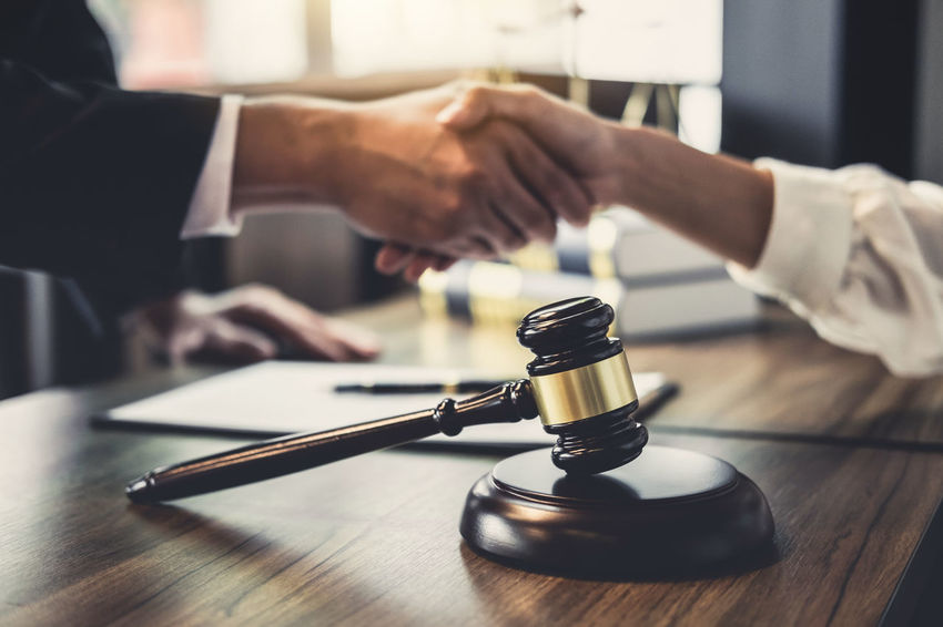 Collaboration Lawyer Barrister Body Part Business Connection Cooperation Counselor Fairness Gavel Hand Handshake Holding Human Body Part Human Hand Human Limb Indoors  Judgement Legal Legislation Men Occupation People Shaking Hands Two People