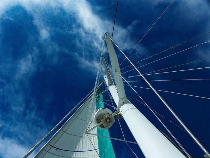 Low angle view of sailboat mast against sky
