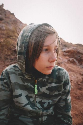 Portrait of teenage girl looking away