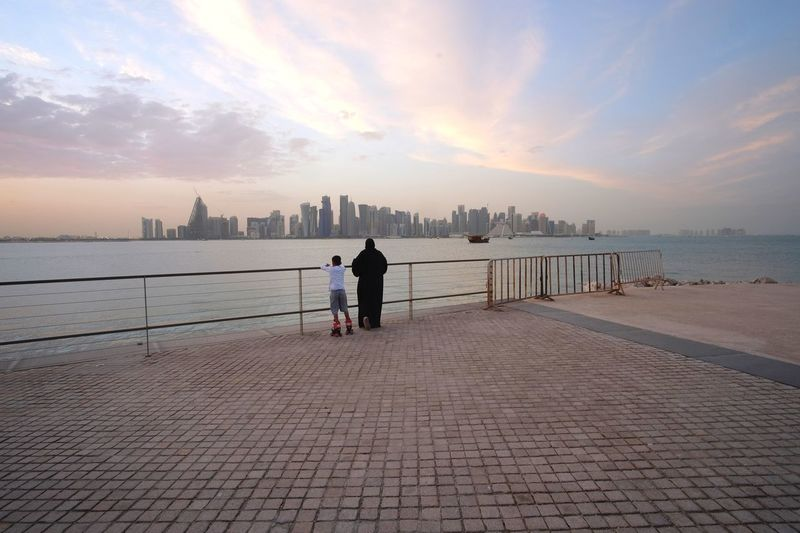 Family day at doha qatar Qatarlife Doha Qatar Sky Water Real People One Person Beach Men Architecture Sea Leisure Activity Full Length Lifestyles Land Women Built Structure Cloud - Sky Beauty In Nature Nature Sunset Outdoors