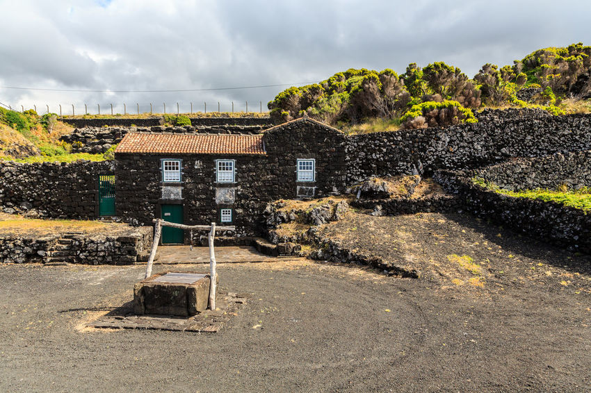 Azores Houses Pico Island Absence Architecture Basaltic Rock Building Building Exterior Built Structure Cloud - Sky Day Empty History House Land Nature No People Outdoors Plant Scenics - Nature Sky Sunlight The Past Tipical House Tree