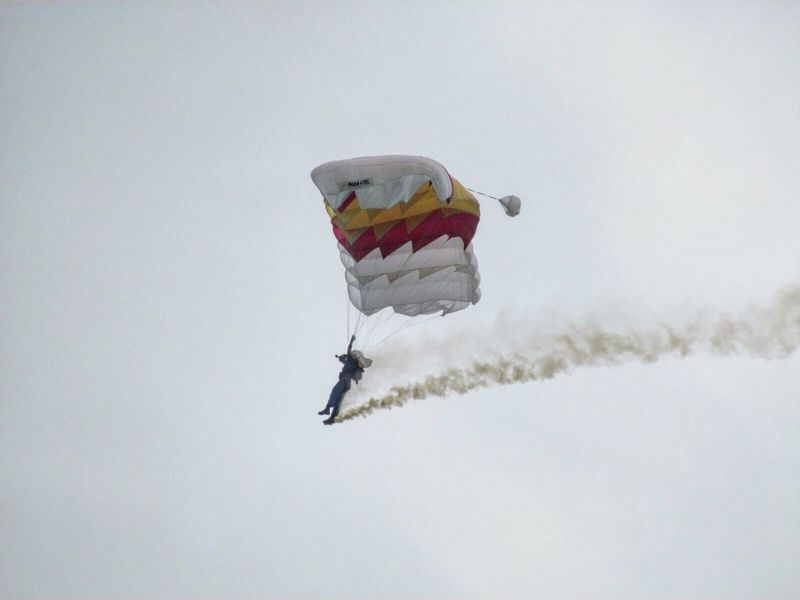 Parachuting Snow Winter Cold Temperature Season  Weather Mid-air Sport Adventure Extreme Sports Nature No People Tranquil Scene Exploration Non-urban Scene Tranquility Military Airplane Atmosphere Diminishing Perspective Flight Growth Music Festival Lifestyles Beauty In Nature Low Angle View Air Vehicle