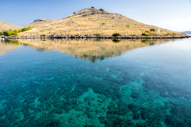BEautiful Kornat, Tleascica, Adriatic sea, vacations Croatia Telašćica Vacations Adriatic Sea Beauty In Nature Blue Boat Day Idyllic Kornati Lake Nature No People Non-urban Scene Outdoors Reflection Sailing Scenics - Nature Summer Tranquil Scene Tranquility Turquoise Colored Water Waterfront Yacht