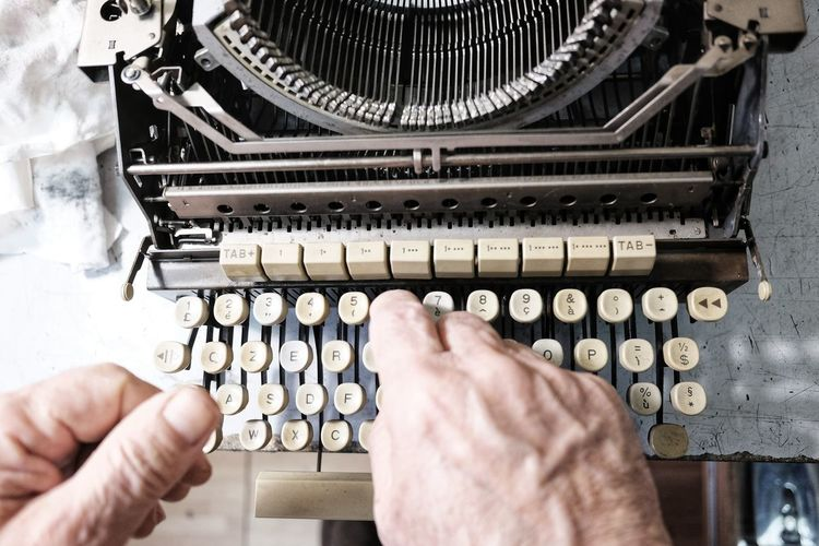 To Type Machine Machine Part Obsolete Technology Man Types On The Typewriter Retro Old Typewriter Human Hand Technology Close-up Typewriter Machine Typescript Vintage Analog Alphabet Old Typing Hand Letter E Letter A